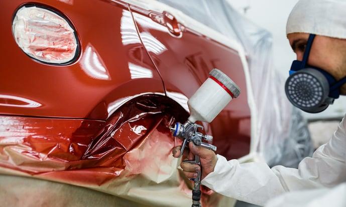 technician painting a car